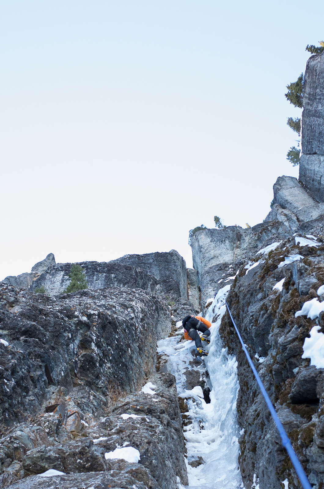 Oli, on one of the steep ice sections, headed for the chimneys.